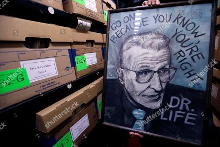 Stock Image of A 1993 drawing of Dr. Jack Kevorkian, drawn by supporter Rachel Reed, is held up for a photo at the Bentley Historical Library in Ann Arbor, Mich., . The University of Michigan library announced Tuesday that is has acquired Kevorkian's papers and is making them publicly available as part of an effort to help people better understand the assisted-suicide advocate and his role in the right-to-die debate. The library said Ava Janus, Kevorkian's niece and sole heir, donated the collection, which spans from 1911 to 2014