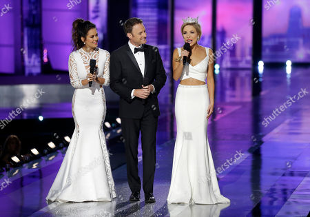 Chris Harrison, Brooke Burke-Charvet, Kira Kazantsev Hosts Chris Harrison, center, and Brooke Burke-Charvet, left, join Miss America 2015 Kira Kazantsev during the Miss America 2016 pageant, in Atlantic City, N.J