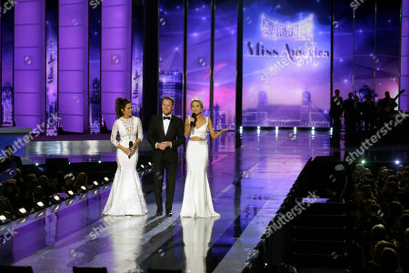 Chris Harrison, Brooke Burke-Charvet, Kira Kazantsev Hosts Chris Harrison, center, and Brooke Burke-Charvet, left, join Miss America 2015 Kira Kazantsev during the 2016 Miss America pageant, in Atlantic City, N.J