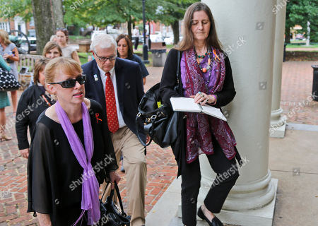 Jill Harrington, Dan Harrington Jill Harrington, left, and Dan Harrington, center, parents of Morgan Harrington, arrive at court to attend a hearing for Jess Matthew, who has been charged in the murder of their daughter, in Charlottesville, Va., . Lawyers for Matthew are asking a judge to consider Matthew's difficult upbringing ahead of his sentencing this week for a 2005 sexual assault. Matthew is awaiting trial in the killings of college students Hannah Graham and Morgan Harrington