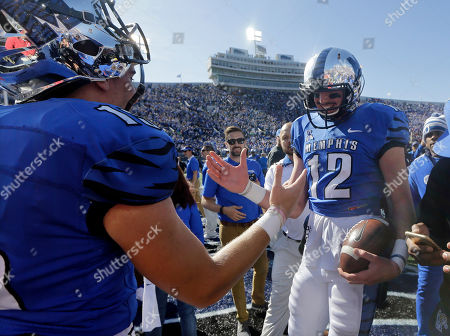 Paxton Lynch, Jason Stewart Memphis quarterback Paxton Lynch (12) celebrates with quarterback Jason Stewart, left, after they upset No. 13 Mississippi 37-24 in an NCAA college football game, in Memphis, Tenn