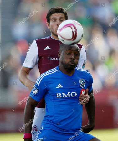 Nigel Reo-Coker, Dillon Powers Montreal Impact's Nigel Reo-Coker, front, heads the ball in front of Colorado Rapids' Dillon Powers during the first half of an MLS soccer match in Commerce City, Colo