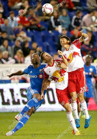 Didier Drogba, Damien Perrinelle, Sean Davis Montreal Impact forward Didier Drogba, left, competes for the ball against New York Red Bulls defender Damien Perrinelle, center, and midfielder Sean Davis during the second half of an MLS soccer match, in Harrison, N.J. The Red Bulls won 2-1