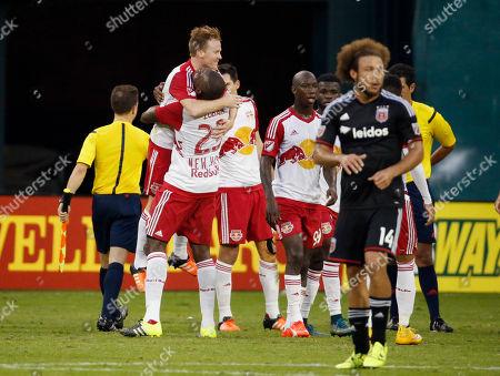 Ronald Zubar, Dax McCarty, Nick DeLeon New York Red Bulls defender Ronald Zubar (23) picks up midfielder Dax McCarty (11) as D.C. United midfielder Nick DeLeon (14) walks off the field after an MLS playoff soccer match, at RFK Stadium, in Washington. New York won 1-0