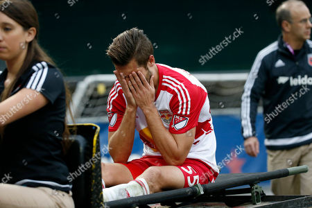 Damien Perrinelle New York Red Bulls defender Damien Perrinelle (55) holds his face in his hands after he left the game with an injury during the second half of an MLS playoff soccer match against the D.C. United, at RFK Stadium, in Washington. New York won 1-0