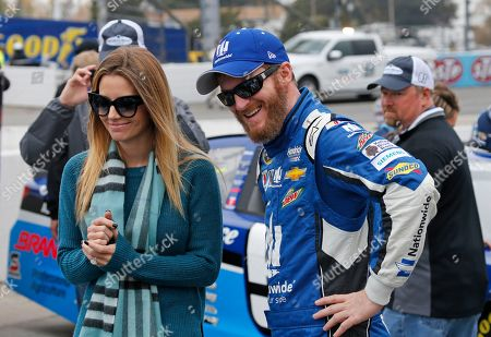 Dale Earnhardt Jr., Amy Reimann Sprint Cup Series driver Dale Earnhardt Jr. (88) talks with his fiance, Amy Reimann, prior to the Sprint Cup auto race at the Martinsville Speedway in Martinsville, Va