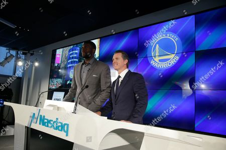 """Gavin Newsom, Festus Ezeli Calif. Lt. Governor Gavin Newsom, right, with Golden State Warriors' Festus Ezeli during the opening in of the Nasdaq Entrepeneurial Center, in San Francisco. New York-based Nasdaq, through an affiliated foundation, is opening what it calls an """"Entrepreneurial Center"""" Thursday in a trendy commercial district south of San Francisco's Market Street. It's promising business training, mentoring and networking opportunities for early stage startup founders"""