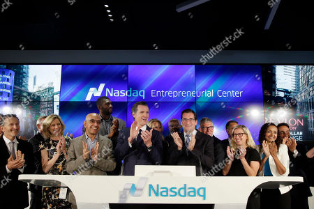 Robert Greifeld; Gavin Newsom; Festus Ezeli Dignitaries, including Calif. Lt. Governor Gavin Newsom, center left, Nasdaq CEO Robert Greifeld, center right, and Golden State Warriors' Festus Ezeli, rear left center, join in applause during the unveiling of the Nasdaq Entrepreneurial Center, in San Francisco. Facing stiff competition from rival exchanges to lure the next hot IPO, New York-based Nasdaq, through an affiliated foundation, opened the center to provide business training, mentoring and networking opportunities for early stage startup founders - maybe even the next Mark Zuckerberg or Larry Page