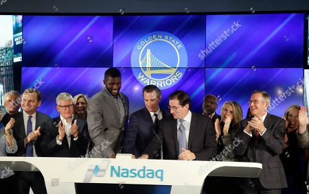Robert Greifeld; Gavin Newsom; Festus Ezeli Dignitaries, including Calif. Lt. Governor Gavin Newsom, center, Nasdaq CEO Robert Greifeld, center right, and Golden State Warriors' Festus Ezeli, center left, ring the closing bell for the Nasdaq exchange during the unveiling of the Nasdaq Entrepreneurial Center, in San Francisco. Facing stiff competition from rival exchanges to lure the next hot IPO, Nasdaq, through an affiliated foundation, opened the center to provide business training, mentoring and networking opportunities for early stage startup founders - maybe even the next Mark Zuckerberg or Larry Page