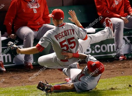 Stephen Piscotty, Kolten Wong St. Louis Cardinals' Stephen Piscotty (55) collides with Kolten Wong (16) as Piscotty catches a foul ball hit by Chicago Cubs Starlin Castro (13) during the fifth inning of Game 3 in baseball's National League Division Series, in Chicago