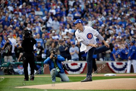 Kerry Wood Former MLB baseball player Kerry Wood throws a ceremonial first pitch before Game 4 in baseball's National League Division Series between the Chicago Cubs and the St. Louis Cardinals, in Chicago