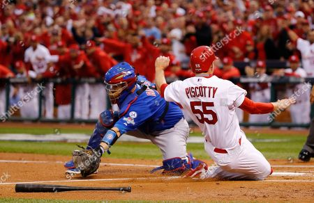 Stephen Piscotty St. Louis Cardinals' Stephen Piscotty (55) slides safely past Chicago Cubs catcher David Ross during the first inning of Game 1 in baseball's National League Division Series, in St. Louis. Piscotty scored on a hit by Matt Holliday