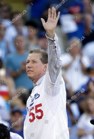 Orel Hershiser Former Los Angeles Dodgers pitcher Orel Hershiser on his way to throwing out a ceremonial first pitch before Game 5 of baseball's National League Division Series between the Dodgers and the New York Mets, in Los Angeles