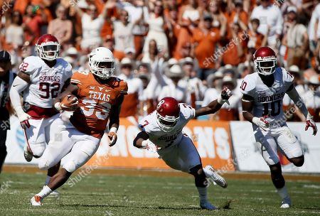D'Onta Foreman, Jordan Thomas, Matthew Romar, Steven Parker Texas running back D'Onta Foreman (33) sprints across the field on a long run as Oklahoma defensive tackle Matthew Romar (92), cornerback Jordan Thomas (7) and safety Steven Parker (10) chase in the second half of an NCAA college football game, in Dallas
