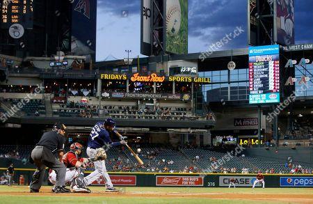 Matt Kemp, Jarrod Saltalamacchia, Tom Hallion San Diego Padres' Matt Kemp (27) fouls off a pitch as umpire Tom Hallion, left, and Arizona Diamondbacks' Jarrod Saltalamacchia watch during the first inning of a baseball game, in Phoenix