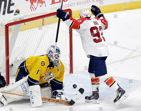 Kyle Rau, Jusse Saros Florida Panthers forward Kyle Rau (92) celebrates a goal by teammate Shane Harper, not shown, against Nashville Predators goalie Jusse Saros (1), of Finland, in the third period of a preseason NHL hockey game, in Nashville, Tenn. The Panthers won in overtime 3-2
