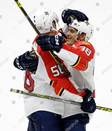 Michael Matheson, Shane Harper Florida Panthers defenseman Michael Matheson (56) celebrates with forward Shane Harper (38) after Matheson scored against the Nashville Predators in the overtime period of a preseason NHL hockey game, in Nashville, Tenn. The Panthers won in overtime 3-2