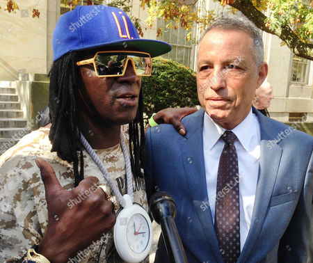 Flavor Flav, William Drayton, Jr., Todd Greenberg Entertainer Flavor Flav, left, standing with attorney Todd Greenberg, speaks with reporters after pleading guilty to one count of aggravated unlicensed operation of a motor vehicle, in Mineola, N.Y. Flav, whose real name is William Drayton, Jr., was arrested in January, 2014 while racing to his mother's funeral on Long Island. A judge in Nassau Criminal Court on Tuesday sentenced Flav to time served, essentially the time he was in custody following the arrest. He was fined $3,600
