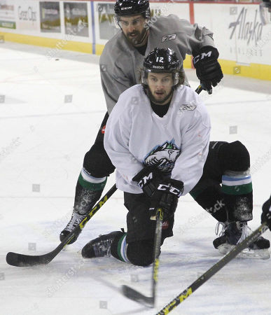 Shows Liam Stewart, forefront, during practice for the Alaska Aces hockey team in Anchorage, Alaska. Stewart, the son of rock superstar Rod Stewart and supermodel Rachel Hunter, says he just wants to be treated as one of the guys
