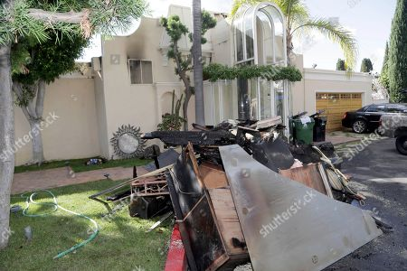 The exterior of the heavily fire-damaged home of singer Johnny Mathis is seen in the Hollywood Hills of Los Angeles . The longtime home of the 80-year-old singer was heavily damaged in the fire that broke out Monday night. Mathis had just flown back to Los Angeles to learn that his home of 56 years caught fire. The cause of the fire was under investigation