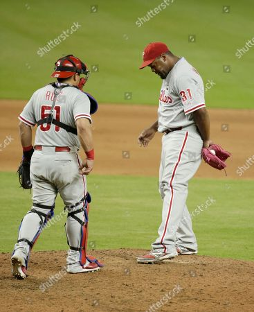 Jerome Williams, Carlos Ruiz Philadelphia Phillies' relief pitcher Jerome Williams (31) talks with catcher Carlos Ruiz (51) in the eleventh inning of a baseball game against the Miami Marlins, in Miami. The Marlins defeated the Phillies 4-3 in eleven innings