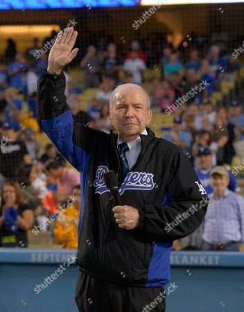 Stock Image of Frank Sinatra Frank Sinatra, Jr. waves after singing the national anthem prior to a baseball game between the Los Angeles Dodgers and the Pittsburgh Pirates, in Los Angeles