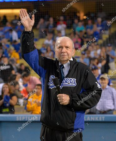 Stock Photo of Frank Sinatra Frank Sinatra, Jr. waves after singing the national anthem prior to a baseball game between the Los Angeles Dodgers and the Pittsburgh Pirates, in Los Angeles