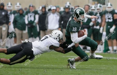 Robert Gregory, Connor Cook Michigan State quarterback Connor Cook (18) is pulled down by Purdue safety Robert Gregory (7) during the second half of an NCAA college football game, in East Lansing, Mich. Cook went 13-of-19 for 139 yards and a touchdown, and he became the school's career leader with his 28th victory as the starting quarterback