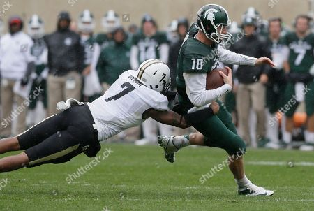 Robert Gregory, Connor Cook Michigan State quarterback Connor Cook (18) is pulled down by Purdue safety Robert Gregory (7) during the second half of an NCAA college football game, in East Lansing, Mich