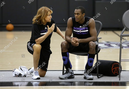 Stock Photo of Nancy Lieberman, Rajon Rondo Sacramento Kings assistant coach Nancy Lieberman talks with guard Rajon Rondo during a workout at the Kings practice facility in Sacramento, Calif., . The Kings open the season against the Los Angeles Clipper at Sleep Train Arena, Wednesday