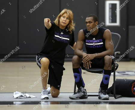 Stock Image of Nancy Lieberman, Rajon Rondo Sacramento Kings assistant coach Nancy Lieberman talks with guard Rajon Rondo during a workout at the Kings practice facility in Sacramento, Calif., . The Kings open the season against the Los Angeles Clipper at Sleep Train Arena, Wednesday. Rondo is one of several free agents signed by the Kings in the off season