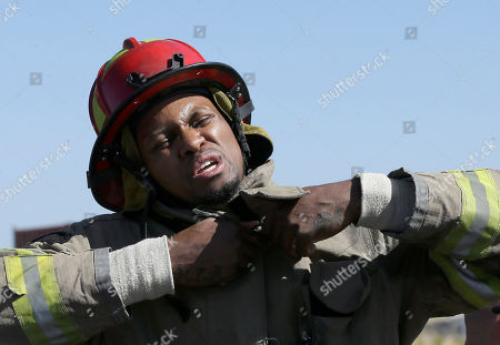 Rudy Gay Sacramento Kings forward Rudy Gay buttons up a fire jacket as he and his teammates began a series a drills at the Sacramento Fire Department training center in Sacramento, Calif., . Under the guidance of firefighting instructors, Kings players went through a series a drills that firefighters perform, as part of team-building exercise in preparation for training camp next week