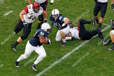 Austin Johnson, Robert Craighead Penn State defensive tackle Austin Johnson (99) returns a fumble by San Diego State quarterback Maxwell Smith for a touchdown with San Diego State offensive lineman Robert Craighead (53) in pursuit during the second half of an NCAA college football game in State College, Pa., . Penn State won 37-21