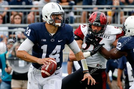 Stock Image of Christian Hackenberg, Ryan Dunn Penn State Nittany Lions quarterback Christian Hackenberg (14) looks to pass under pressure from San Diego State linebacker Ryan Dunn (57) during the first half of an NCAA college football game in State College, Pa