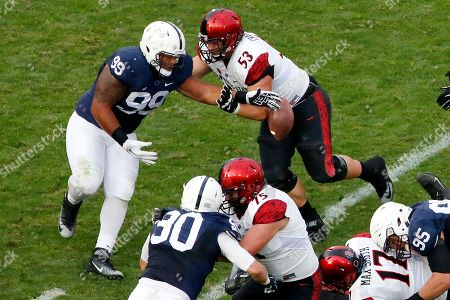 Austin Johnson, Robert Craighead Penn State defensive tackle Austin Johnson (99) reaches for a fumble by San Diego State quarterback Maxwell Smith as San Diego State offensive lineman Robert Craighead (53) attempts to block him during the second half of an NCAA college football game in State College, Pa., . Johnson recovered the fumble and returned it for a Penn State touchdown. Penn State won 37-21