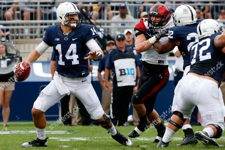 Stock Picture of Christian Hackenberg, Ryan Dunn Penn State Nittany Lions quarterback Christian Hackenberg (14) looks to pass under pressure from San Diego State linebacker Ryan Dunn (57) during the first half of an NCAA college football game in State College, Pa
