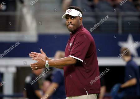 Kevin Sumlin Texas A&M coach Kevin Sumlin applauds his team as players warm up for an NCAA college football game against Arkansas in Arlington, Texas. Steve Shaw has a busy week at the Southeastern Conference's annual meetings. Shaw, the league's coordinator of officials, is getting SEC coaches and administrators prepared for centralized replay, an experimental effort between the SEC office's command center and the replay official at games