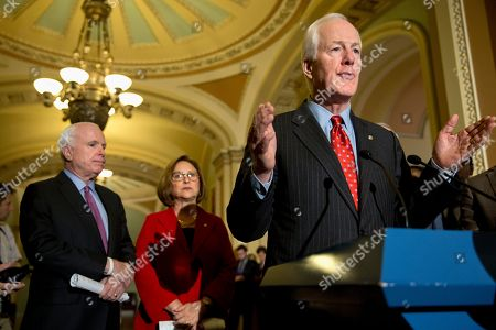 John Cornyn, Deb Fischer, John McCain Senate Majority Whip John Cornyn of Texas, right, accompanied by Sen. John McCain, R-Ariz., left, and Sen. Deb Fischer, R- Neb., speaks during a news conference on Capitol Hill in Washington, on
