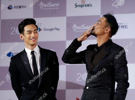 Simon Yam, Han Ji-seok l Hong Kong actor Simon Yam, right, gestures as South Korean actor Han Ji-seok looks, on their arrival to the opening ceremony of the Busan International Film Festival at Busan Cinema Center in Busan, South Korea