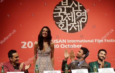 """Sarah Jane Dias, Mozez Singh, Vicky Kaushal, Raaghav Chanana Indian actress Sarah Jane Dias, second from left, is congratulated by Indian director Mozez Singh, left, actor Vicky Kaushal and actor Raaghav Chanana, right, after she sings a song during a press conference for the Busan International Film Festival opening movie """" Zubaan"""" in Busan, South Korea"""