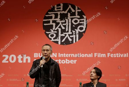"""Hou Hsiao-hsien, Chang Chen Taiwanese director Hou Hsiao-hsien, left, speaks at the gala presentation of his film """"The Assassin"""" as Taiwanese actor Chang Chen who starred in the film looks on during the Busan International Film Festival in Busan, South Korea, . Asia's largest film festival opened its doors on Thursday for 10 days of screenings that will highlight the region's young talent and its rich heritage"""