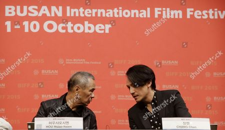"""Hou Hsiao-hsien, Chang Chen Taiwanese director Hou Hsiao-hsien, left, talks with Taiwanese actor Chang Chen at the gala presentation of their film """"The Assassin"""" during the Busan International Film Festival in Busan, South Korea, . Asia's largest film festival opened its doors on Thursday for 10 days of screenings that will highlight the region's young talent and its rich heritage"""