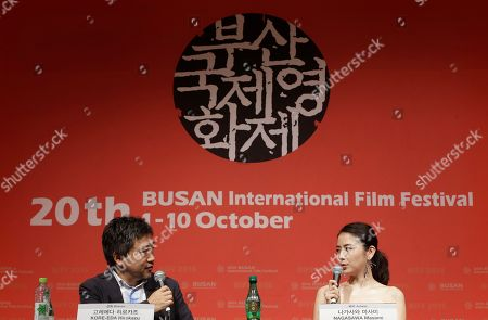 """Stock Photo of Japanese actress Masami Nagasawa, right, talks with Japanese director Hirokazu Koreeda in the Gala Presentation """"Little Sister"""" during the Busan International Film Festival in Busan, South Korea, . Asia's largest film festival opened its doors on Thursday for 10 days of screenings that will highlight the region's young talent and its rich heritage"""