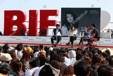 """Jeon Do-yeon South Korean actress Jeon Do-yeon, top third from right, attends """"Open Talk"""" during the Busan International Film Festival in Busan, South Korea, . Asia's largest film festival opened its doors on Thursday for 10 days of screenings that will highlight the region's young talent and its rich heritage"""