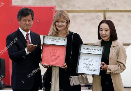 Nastassja Kinski, Lee Yong-kwan Kang Soo-yeon German actress Nastassja Kinski, center, Busan International Film Festival co-Directors Kang Soo-yeon and Lee Yong-kwan, left, of South Korea show Kinski's hand print and autograph in a hand printing ceremony during the Busan International Film Festival in Busan, South Korea, . Asia's largest film festival opened its doors on Thursday for 10 days of screenings that will highlight the region's young talent and its rich heritage