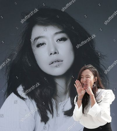 """Jeon Do-yeon South Korean actress Jeon Do-yeon shouts to her fans as she arrives to attend """"Open Talk"""" during the Busan International Film Festival in Busan, South Korea, . Asia's largest film festival opened its doors on Thursday for 10 days of screenings that will highlight the region's young talent and its rich heritage"""