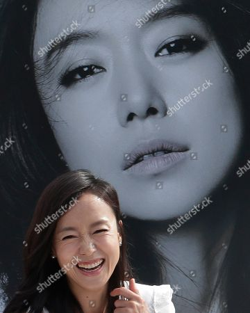 """Jeon Do-yeon South Korean actress Jeon Do-yeon smiles as she arrives to attend """"Open Talk"""" during the Busan International Film Festival in Busan, South Korea, . Asia's largest film festival opened its doors on Thursday for 10 days of screenings that will highlight the region's young talent and its rich heritage"""