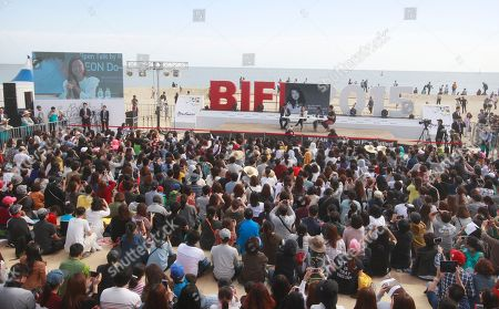 """People crowd as South Korean actress Jeon Do-yeon, top third from right, attends """"Open Talk"""" during the Busan International Film Festival in Busan, South Korea, . Asia's largest film festival opened its doors on Thursday for 10 days of screenings that will highlight the region's young talent and its rich heritage"""