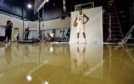 Tim Duncan San Antonio Spurs' Tim Duncan (21) poses for photos during media day at the team's practice facility, in San Antonio