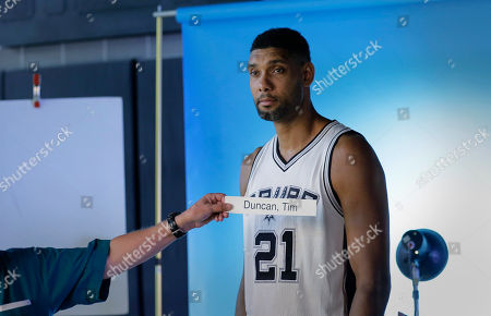 Tim Duncan San Antonio Spurs' Tim Duncan (21) poses for photos during media day, in San Antonio